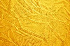 Gold creased fabric silk. For background Royalty Free Stock Photos