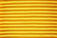 Gold creased fabric silk Stock Photo