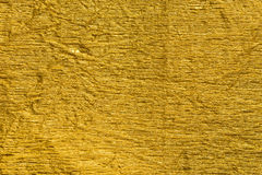 Gold creased metallic foil background texture Royalty Free Stock Photography