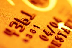 Gold credit card. Golden credit card background closeup Stock Photo