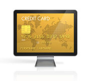 Gold credit card on a computer screen Royalty Free Stock Images