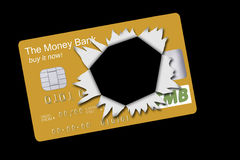 Gold credit card exploded, debt finance metaphor Royalty Free Stock Image