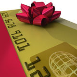 Gold credit card with fancy red ribbon Royalty Free Stock Images