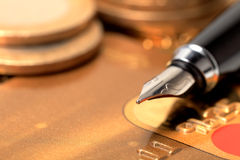 Gold credit card and ink pen Royalty Free Stock Photo