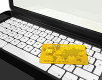 Gold credit card on laptop Stock Photo