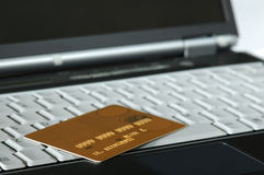 Gold Credit Card and Notebook. Gold Credit Card atop a Notebook stock photo