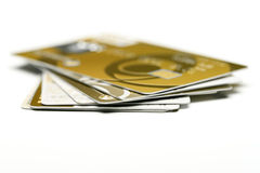Gold credit cards isolated on white background Stock Images