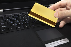Gold credit and laptop Royalty Free Stock Image