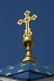 Gold cross. And gold stars on dome over blue sky stock image