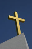 Gold Cross. Cross decorated with gold tiles, on the roof of a church Royalty Free Stock Photos