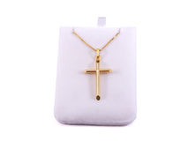 Gold cross. On a chain, isolated with clipping path Stock Photography