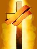 Gold Cross with banner over glowing background Stock Images