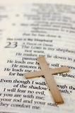Gold cross and bible with selective focus Royalty Free Stock Photos