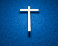 Gold Cross on Blue background Royalty Free Stock Image