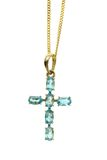 Gold Cross with blue gemstones. Cross pendant with topaz stones Stock Photos