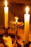 Gold cross with candles and  sprinkler on wooden background. Stock Photo