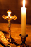 Gold cross with candles and  sprinkler on wooden background. Stock Images