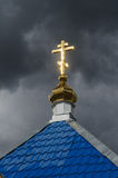 Gold cross on a church. The roof of the church, golden Orthodox cross Royalty Free Stock Image