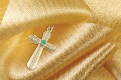 Gold cross with diamonds and emerald  Stock Image