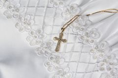 Gold Cross with First Communion Dress royalty free stock photos