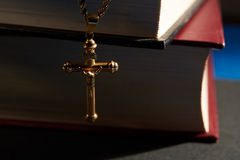 Gold cross hanging on Book Stock Photography