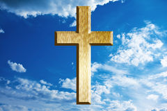 Gold cross on heaven Stock Photos