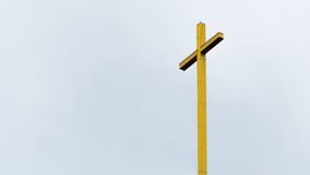 Gold cross isolated Stock Photography