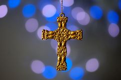 Gold cross ornament on a blue background Stock Image