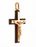 Gold cross pendant  with a crucifix Stock Image