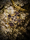 Gold cross on a tree bark christianity, smutty Royalty Free Stock Images