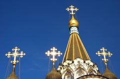 Gold crosses on the dome on the blue sky background on the Church of the Resurrection in Sokolniki, Moscow, Russia. Close-up. Horizontal view Stock Images