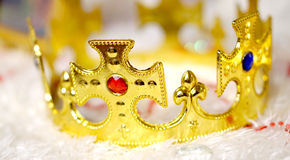 Gold crown with diamond on white fur background Stock Photography