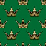 Gold crown on green in a seamless pattern Stock Photography