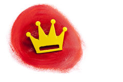 Gold crown in red bloody paint. Background with copy space. Winner after destroying enemies Royalty Free Stock Images