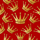 Gold crown on a red. Seamless vector background. Stock Photo
