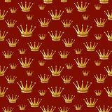 Gold crown on a red. Seamless vector background. Royalty Free Stock Image