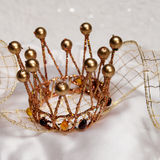 Gold crown on a white background Stock Images
