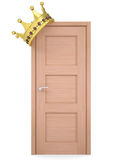 Gold crown on a wooden door Stock Photo