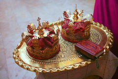 Gold crowns for wedding and Bible Stock Image