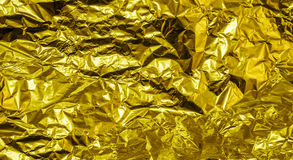 Gold crumpled aluminum foil texture background Stock Photo