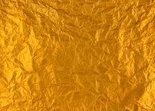 Gold crumpled foil. Stock Photo