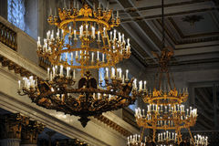 Gold and Crystal Chandeliers Hang in St. Petersburg& x27;s Winter Palace, or Hermitage Museum. Sparkling gold and crystal chandeliers hang in a royal reception Stock Photography
