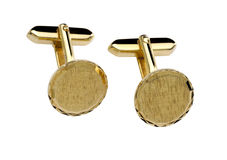 Gold cuff link. Isolated on white background Stock Images