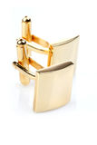 Gold cuff links on white background Royalty Free Stock Photography