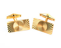 Gold cufflinks Royalty Free Stock Photos