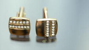 Gold Cufflinks are On a Glass Table stock video