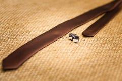 Gold cufflinks and tie groom Stock Photo