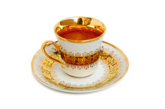 Gold cup. Gold coffee or tea cup on white background royalty free stock images
