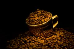 Gold cup of coffee Stock Photography