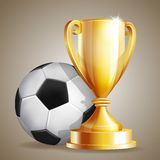 Gold cup with a football ball Stock Photos